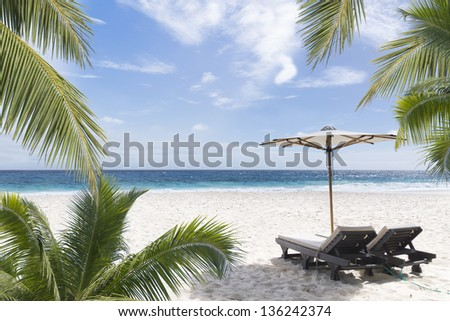 Beach chair at sunny coast. Seychelles. Mahe island. - stock photo
