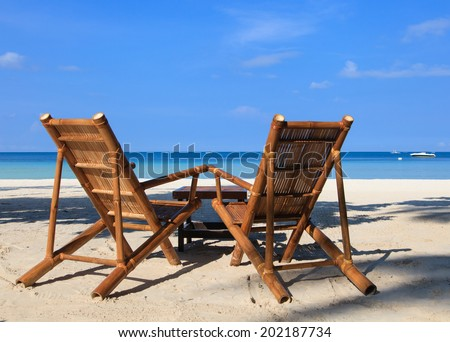beach chairs of tropical sand beach in Boracay, Philippines - stock photo