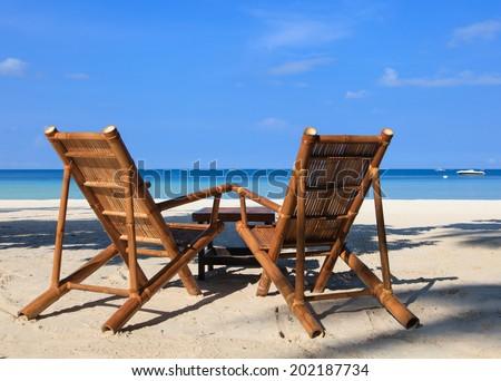 beach chairs of tropical sand beach in Boracay, Philippines - stock photo