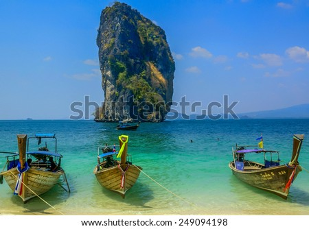 Beach in Thailand - March 6,2014: Boats parked by the beach in Thailand waiting for tourist groups to arrive.