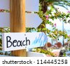 """Beach"" sign pointing at beach - stock photo"