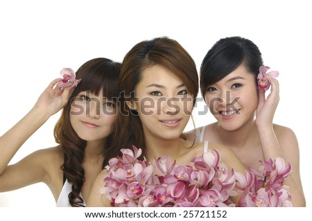3 beautiful asian woman with orchid - stock photo