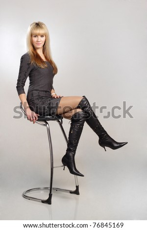 beautiful blond sexy woman sitting on chair - stock photo