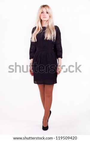 Beautiful blonde in a black dress - stock photo