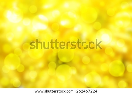 Beautiful bokeh effect showing a vibrant yellow background - stock photo