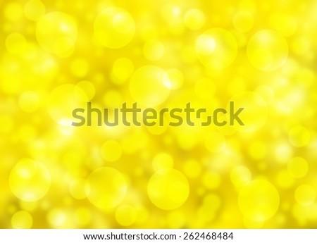 Beautiful bokeh effect showing a vibrant yellow background - stock photo