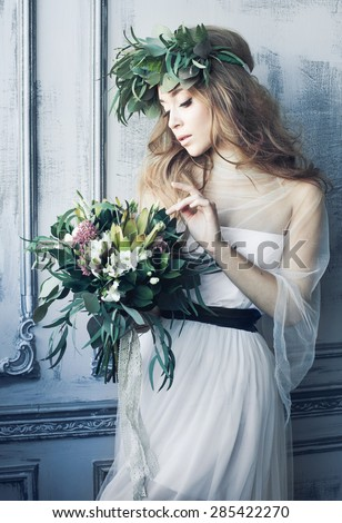 Beautiful Bride in decor, girl with flowers,  - stock photo