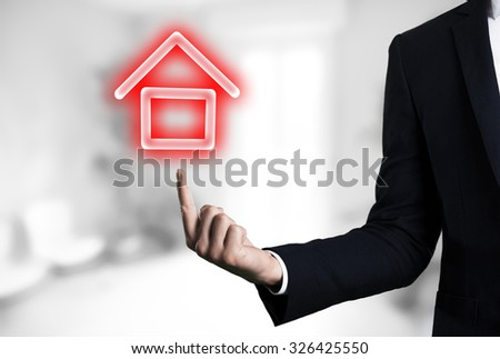 beautiful Business male arm indicating house glow icon.