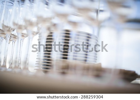 Beautiful champagne glasses defocused on buffet table in restaurant and blurred background - stock photo