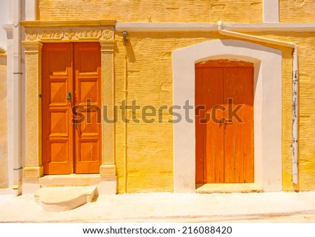 2 beautiful doors from an old building at Chora, the capital of Andros island in Greece - stock photo