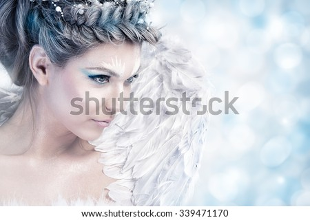 Beautiful fairy winter with wings - stock photo