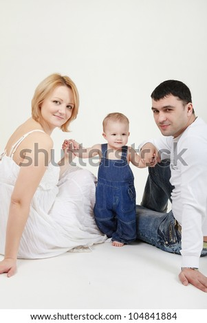Beautiful family portrait smiling over a white background - stock photo