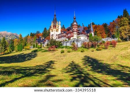 Beautiful famous royal castle and ornamental garden with majestic autumn colors,Peles castle,Sinaia,Transylvania,Romania,Europe - stock photo