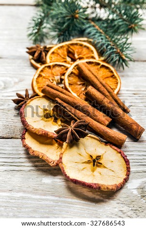 beautiful festive Christmas still life of the branches of spruce, spice on wood background