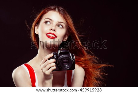 beautiful girl in red with photo camera