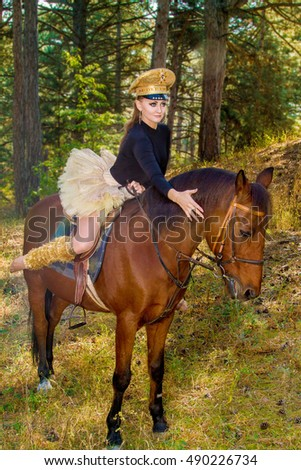 beautiful girl in uniform on horseback