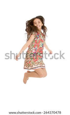 Beautiful girl jumps legs crossed. - isolated on white background - stock photo