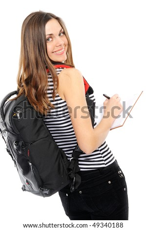 beautiful girl with a backpack, holds the book on a white background