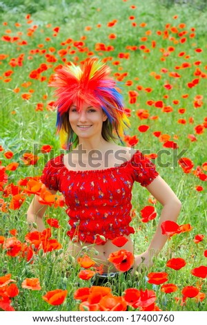 beautiful girl with colorful wig on a field with poppies