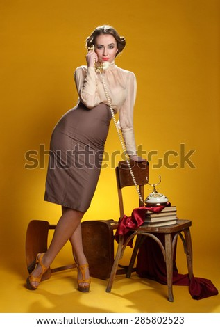beautiful girl with phone, pin-up girll , vivid emotions, hairstyle and makeup style pin-pack, a good figure