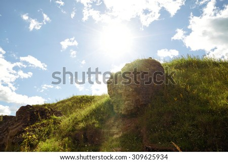 Beautiful green hills with amazing sunlight - stock photo