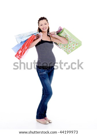 Beautiful happy smiling pregnant woman with shopping bags - isolated on white - stock photo