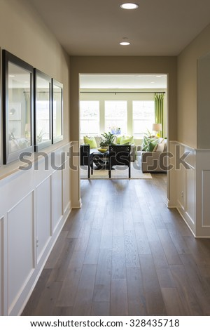 Beautiful Home Entry Way with Wood Floors and Wainscoting. - stock photo