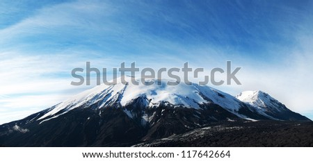 beautiful landscape of blue sky and mountain peak with snow