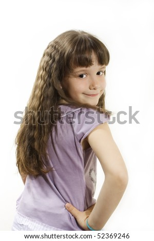 Beautiful little girl with long hair, posing.