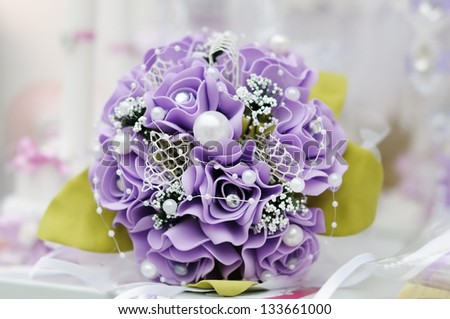 Beautiful purple wedding flowers bouquet - stock photo