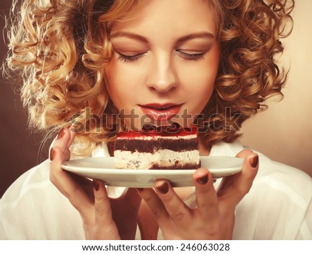 beautiful smiling young blond woman with a cake