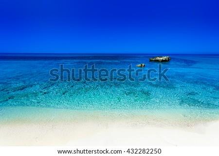 Beautiful Sunny Beach Coastline with Panorama Tranquility Bay. Beach vacation background - stock photo