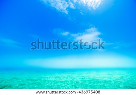 Beautiful Sunny Beach Coastline with Panorama Tranquility Bay. Beach vacation background. Abstract Blurry Wallpaper Resort Scene  - stock photo