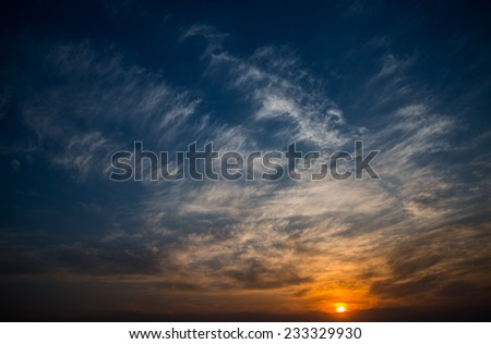 Beautiful sunset sky with sun.   - stock photo