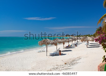 Beautiful tropical  beach at the Caribbean island with white sands and  stunning turquoise waters