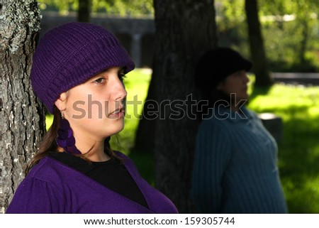 beautiful woman in an autumn park