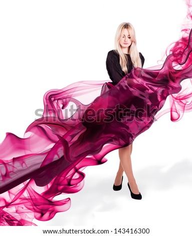 Beautiful woman in red waving chiffon - stock photo