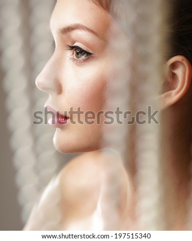 beautiful woman, portrait isolated on grey background - stock photo