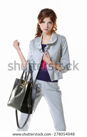 beautiful woman with bag posing on white background - stock photo