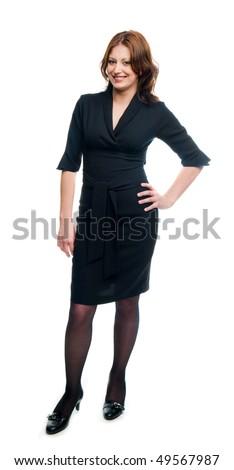 Beautiful young adult girl in black elegant dress posing in studio - stock photo