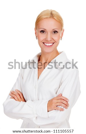 Beautiful young businesswoman standing with hands folded against white background