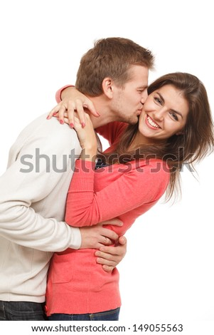 beautiful young couple embracing and laughing