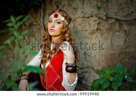Beautiful young girl hippie posing outdoor - stock photo