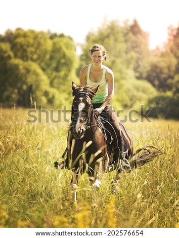 beautiful young happiness woman on a horse riding - stock photo