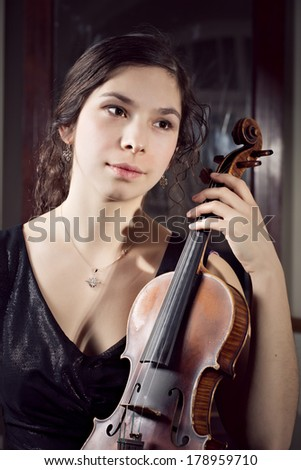 beautiful young happy woman play violin music instrument