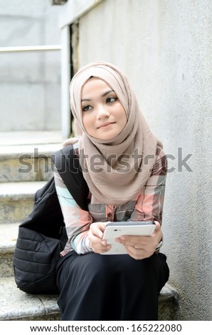 beautiful young muslim student sad while looking result at laptop  - stock photo