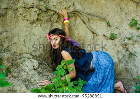 Beautiful young sexy girl hippie posing outdoor - stock photo