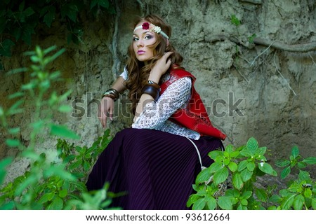 beautiful young woman hippie in a forest - stock photo