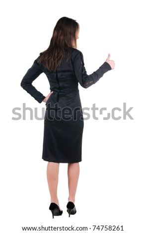 Beautiful young woman in dress gesture thumbs up. Rear view. Isolated over white.