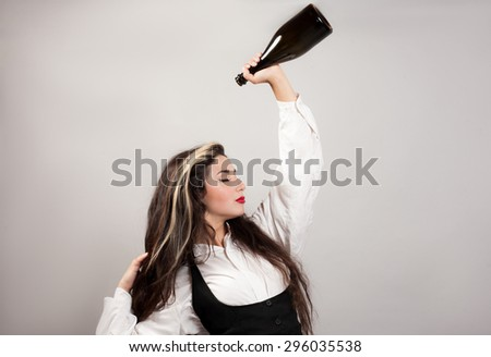 beautiful young woman pours over a head wine - stock photo